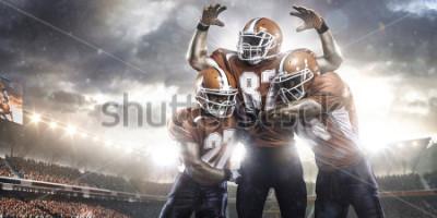 Фотообои Игроки в американский футбол в действии на панораме стадионе