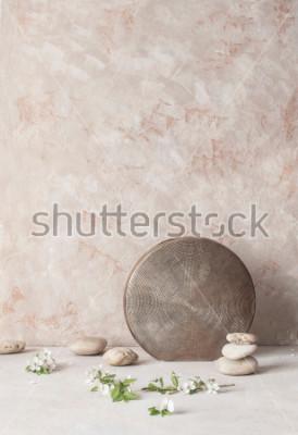 Фотообои Натюрморт с цветами, камнями и тиснением керамическая ваза на текстурированном фоне стены в стиле Ваби-Саби. Выборочный фокус.