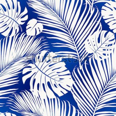 Фотообои Бесшовные повторяющийся узор с белыми силуэтами пальмовых листьев на синем фоне.