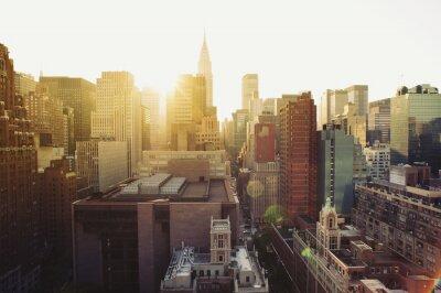 Фотообои Нью-Йорка Манхэттена вид небоскребов в солнечном свете.