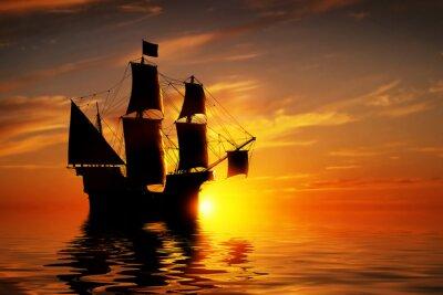 Фотообои Старый древний пиратский корабль на мирном океане на закате.