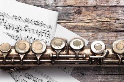 Фотообои Старая флейта с ноты на ржавых деревянных досках