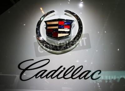 Фотообои ПАРИЖ - 14 октября: General Motors Co. (GM) Cadillac логотип находится на вольт компании во время Парижском автосалоне 2010 в Порт-де-Версаль, 14 октября 2010 года в Париже, Франция