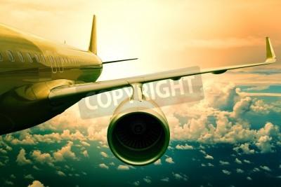 Фотообои пассажирский самолет самолет вывешивать выше облаков отпущения использования для перевозки самолетов и путешествия фоне бизнес-