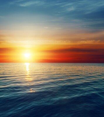Фотообои красный закат над темной водой