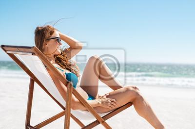 Фотообои Relaxed woman sunbathing at beach