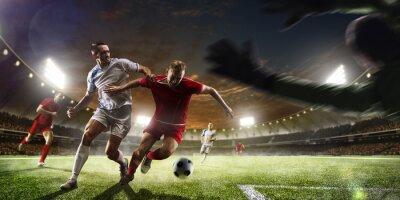 Фотообои Футболисты в действии на фоне панорамы закат стадион