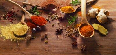 Фотообои Специи и травы на деревянный стол.