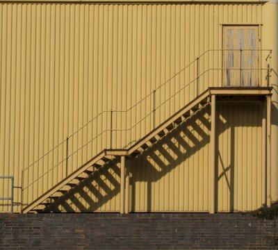 Фотообои Лестница по металлической sidinf стене.