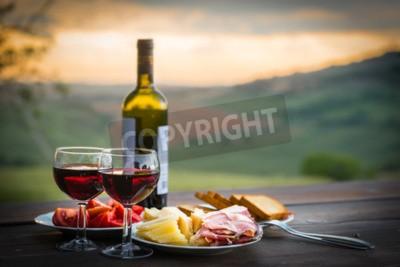 Фотообои натюрморт Красное вино, сыр и ветчина. Романтический ужин на открытом воздухе