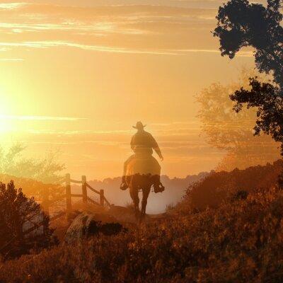 Фотообои Закат Cowboy. Ковбой уезжает в закат в прозрачных слоев оранжевыми и желтыми облаками, забор и деревья.