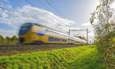 Фотообои Train driving towards the sun in autumn