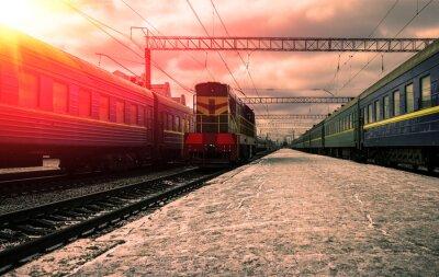 Фотообои Поезд в лучах красного солнца