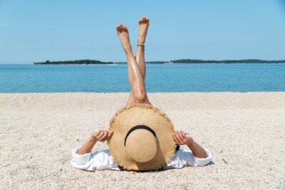 Фотообои woman sunbathing at sea beach. summer vacation