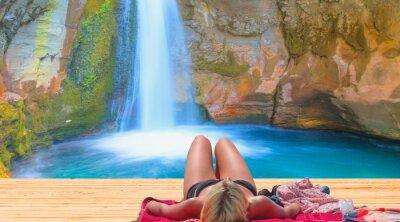 Фотообои Woman sunbathing at the Sapadere waterfall - Natural pools with blue water in a rocky Sapadere waterfall and canyon - Alanya, Turkey