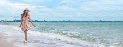 Фотообои Young happy woman walking on the beach with enjoying on summer beach holiday vacation.