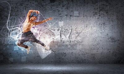 Фотообои Молодой человек танцует хип-хоп с цветными линиями