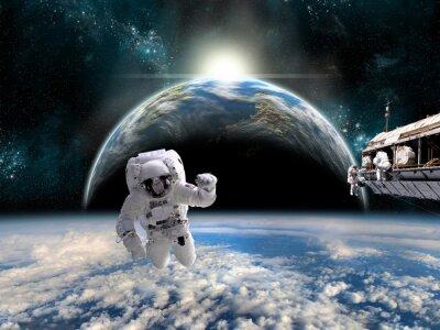 Плакат Команда астронавтов работать на космической станции - Элементы этого изображения, предоставленную NASA.