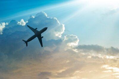 Плакат Самолет в небе и облака на рассвете