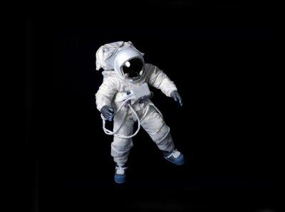 Плакат Астронавт плавающей на черном фоне.