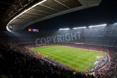 Плакат BARCELONA, SPAIN - DECEMBER 13, 2010: Panoramic view of the Camp Nou, the stadium of Football Club Barcelona team, before the match FC Barcelona - Real Sociedad, final score 5 - 0.