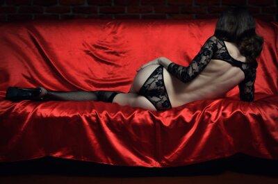Плакат Красивая и сексуальная молодая женщина в эротическом белье и чулки