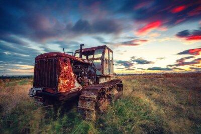 Плакат Красивый закат над полем и старый ржавый трактор