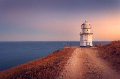 Плакат Красивый белый маяк на побережье океана на закате. ЛВС