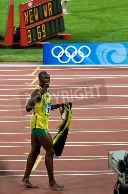 Плакат Beijing, China - Aug 16: Sprinter Usain Bolt sets new 100 meter world record for men
