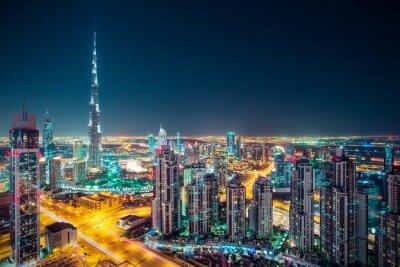 Плакат Фантастический вечер Дубай горизонта с подсветкой небоскребов. Крыше перспектива центра Дубая, ОАЭ.