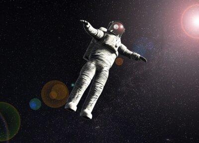 Плакат плавающие космонавта в космосе с солнцем