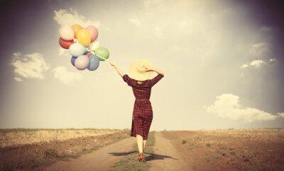 Плакат Девушка с разноцветными воздушными шарами и сумки