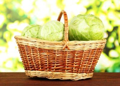 Плакат Зеленая капуста в плетеной корзине, на светлом фоне