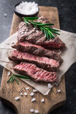 Плакат Жареный стейк из говядины с розмарином и солью на разделочной доске