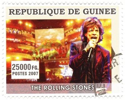 Плакат Гвинея - около 2007 известный рок-певец Мик Джаггер из музыкального коллектива Rolling Stones
