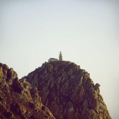Плакат Маяк на вершине каменной скалы