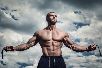 Плакат Muscular man under cloudy sky