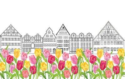 Плакат Старые здания и дома в Амстердаме с тюльпанами цветок переулка.