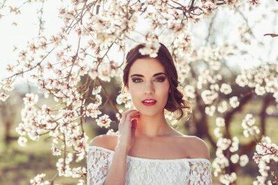 Плакат Портрет молодой женщины в цветущем саду весной тим