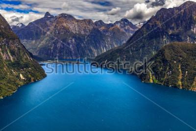 Плакат Новая Зеландия. Милфорд Саунд (Пиопиотахи) сверху - глава фьорда, аэропорт Милфорд Саунд на заднем плане