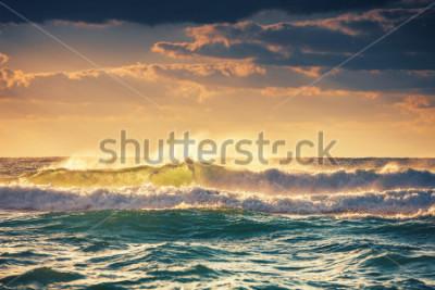 Плакат Sunrise and shining waves in ocean