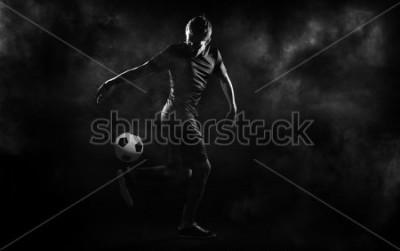 Плакат bright soccer playerl on the black background