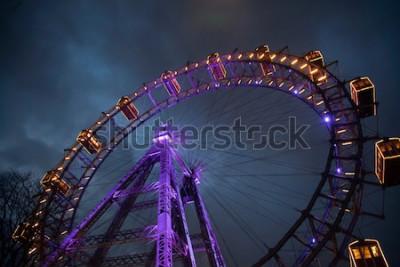 Плакат Колесо обозрения со светом между облаками. Лондонский глаз. Зима. Ночное небо и облака. Англия. Великобритания