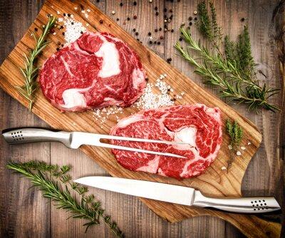 Плакат Сырье свежее мясо Рибай стейк с травами и специями. Ретро стиль