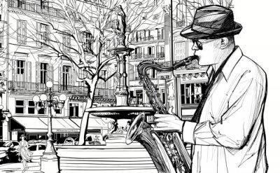 Плакат саксофонист на одной из улиц Парижа