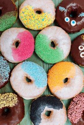 Плакат различные испеченные пончики, сладкая пища