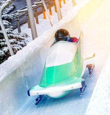 Плакат Wintersport - Bobschlitten in der Eisbahn