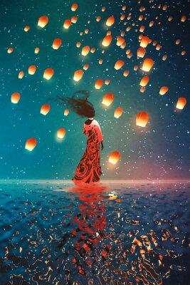 Плакат женщина в платье, стоя на воде против плавающих фонарей в ночное небо, иллюстрации картина
