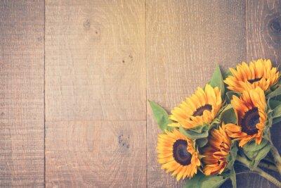 Наклейка Осенний фон с подсолнухами на деревянный стол. Вид сверху. Ретро эффект фильтра