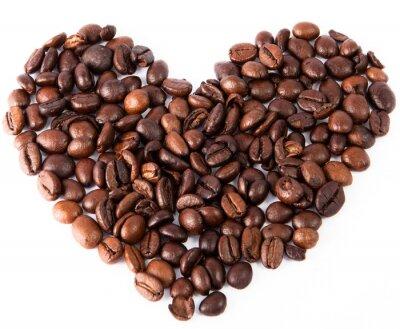 Наклейка крупным планом сердце из натурального коричневого жареного кофе было